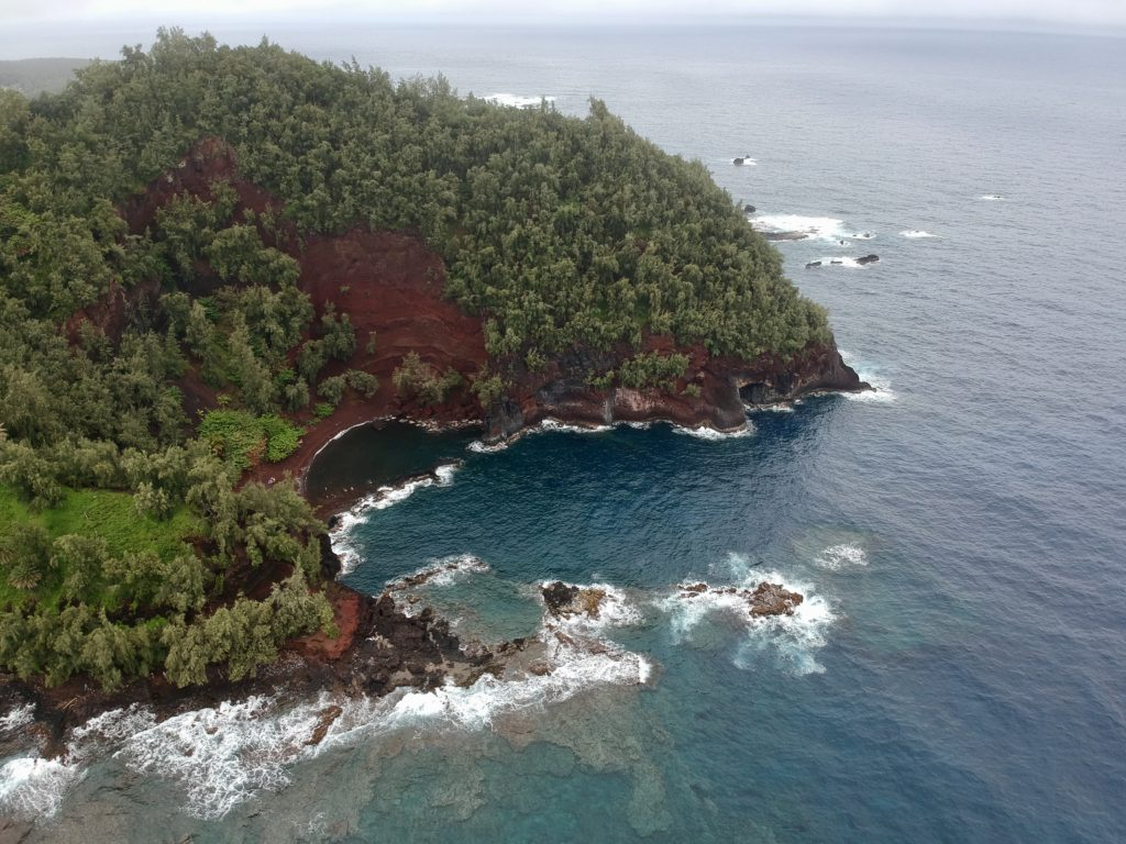Maui's Red Sand Beach The Black Sand Beach on The Road to Hana in Maui. What to do in Maui.