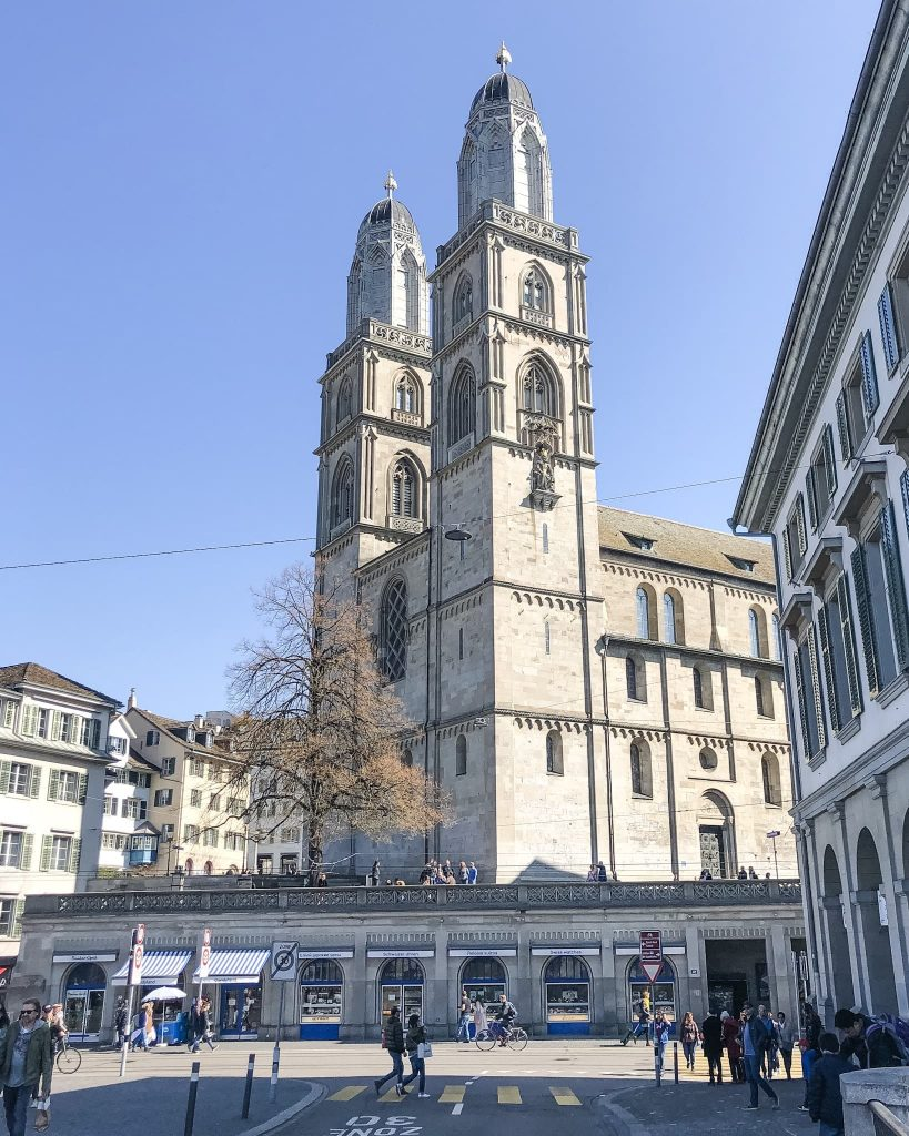 Grossmünster Church. How to Spend a Day in Zurich, Switzerland. View of Grossmünster Church from the bridge.