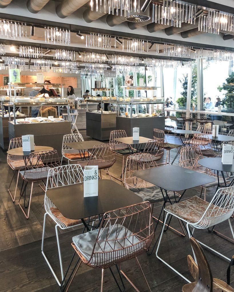 Hiltl Indoor Seating Area. How to Spend a Day in Zurich, Switzerland. Where to eat in Zurich, Switzerland.
