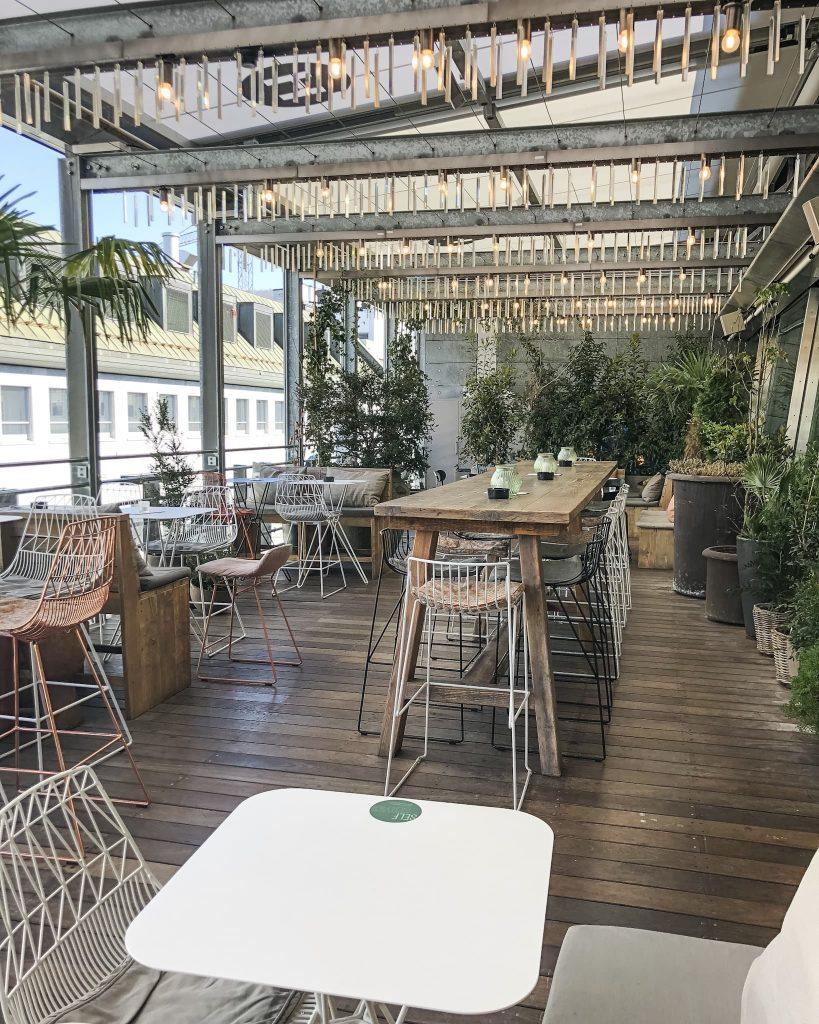 Hiltl Outdoor Sitting Space. How to Spend a Day in Zurich, Switzerland. Where to eat in Zurich, Switzerland.