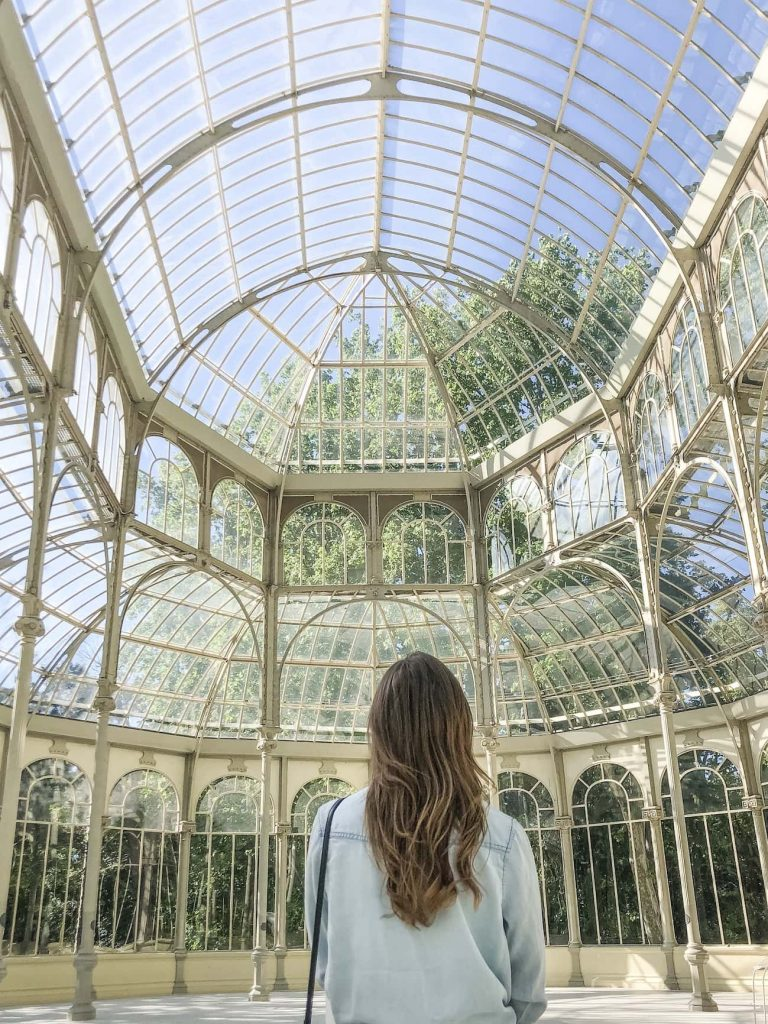 The inside of Palacio de Cristal del Retiro.  The entire palace is made of glass and iron, how cool!   Palacio de Cristal one day in madrid inside