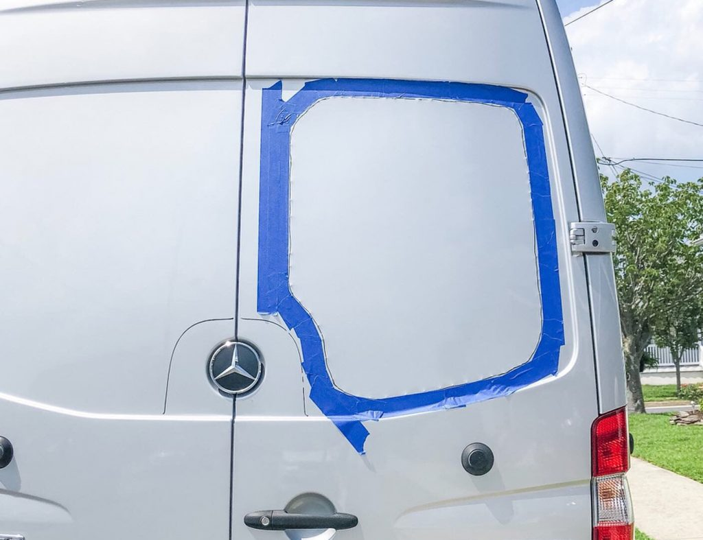 How to install back door windows on a mercedes sprinter van - use masking tape to save the door from scratching