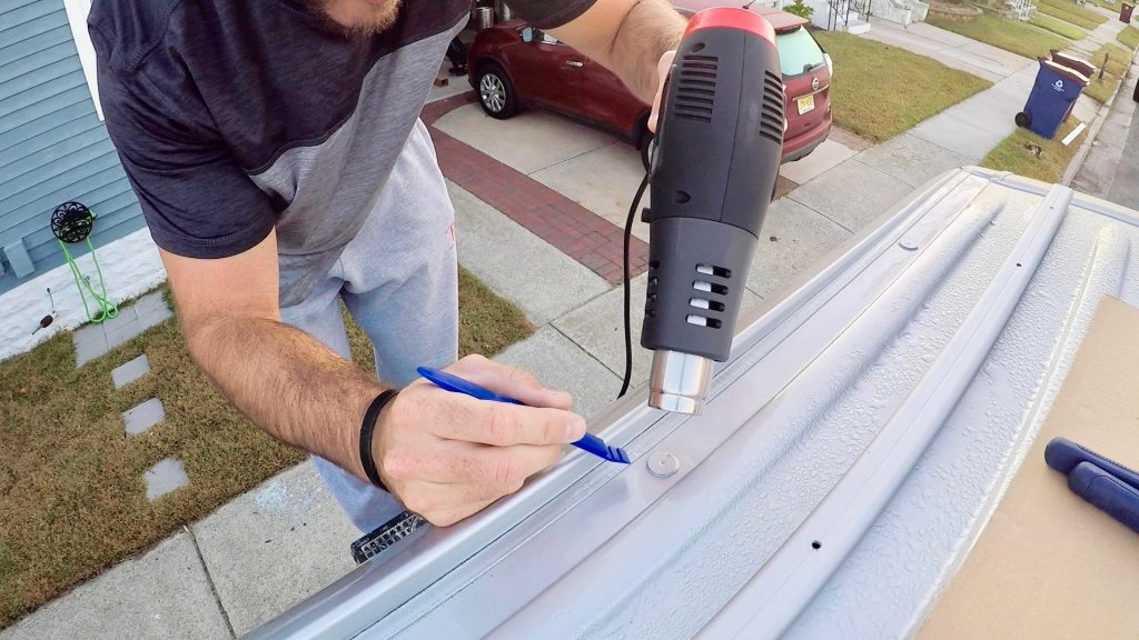 Apply Heat Gun and use chisel to remove plug - roof rail installation