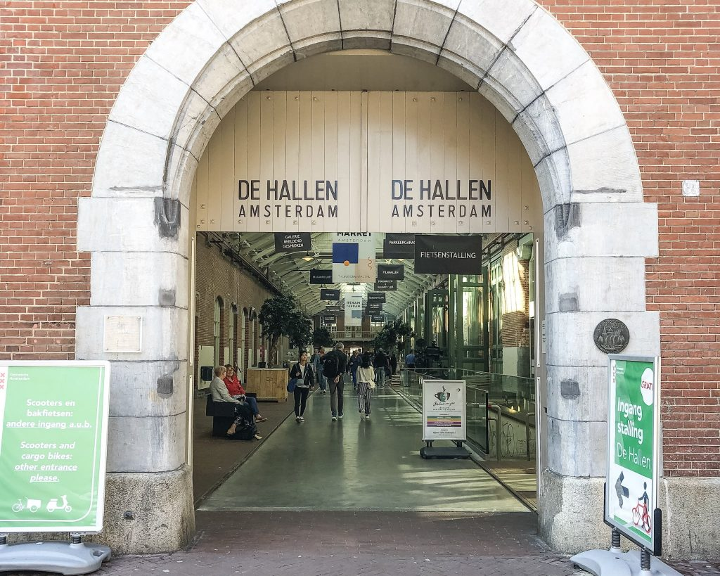 The Best Places to Eat and Drink in the City of Amsterdam. Foodhallen. De Hallen Amsterdam. Where to eat in Amsterdam. Where to eat lunch in Amsterdam. Where to eat dinner in Amsterdam.