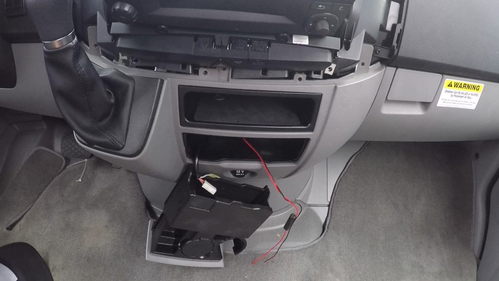 run the power cable from radio display down the center dash to 12v cigarette