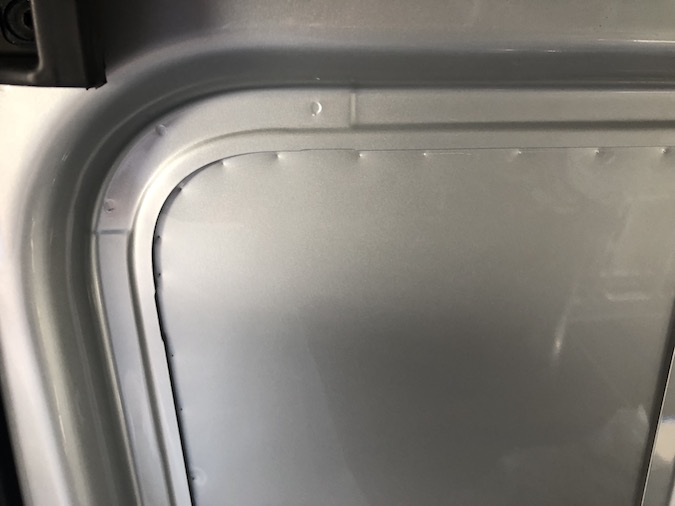 Hammer indents into t-vent window - how to install t-vent CRL window on a sliding door for sprinter van