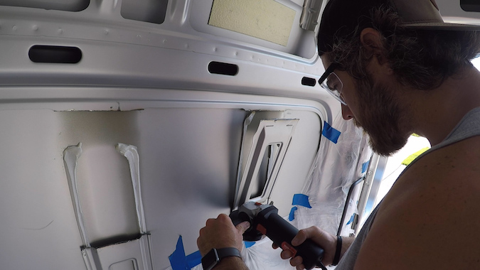 cutting the ribs of the van in window frame