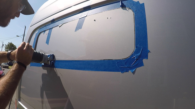 cutting the side of the van - how to install side panel bunk windows on sprinter van
