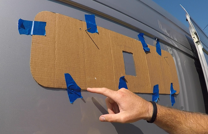 trace template on outside of van for installing a bunk panel window