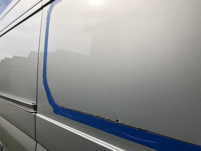 trace the window on outside in preparation from the cut - how to install a t-vent window on a sprinter van